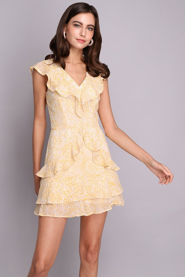 Head Over Heels Romper In Yellow Prints